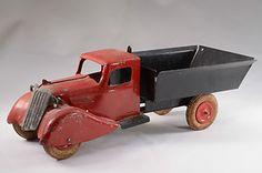 SOLD ......................................Wyandotte toys press steel dump truck Circa 1930; spring loaded dump box in good working order.