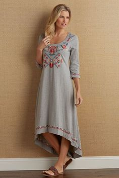 "On-trend embroidered motifs evoke traditional village handicrafts and bring texture and tone to the front, three-quarter sleeves and hem of this soft, cotton slub jersey knit dress. With raw edges and a dropped-tail hem, this versatile garment will take you from spring into summer with charm to spare. Each is a unique creation made for you alone. Cotton. Misses 39""/53"" long. Valencia Embroidered Dress #2AQ06"