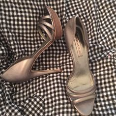 "NEW BCBG Silver/Gray High Heels NEW BCBG ""Haisha"" Pewter Metallic Mestico (Dark Grey/Silver Heel) No Box. The perfect choice for a chic night out! Open toe design. Also has an ankle strap with adjustable buckle closure. Leather Sole, 4.5 Inch Heel. Fits True To Size BCBG Shoes Heels"