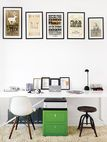 In the office, which is partof the addition, a collection of vintage posters hangs abovea Cbox file cabinet and a table from Blu Dot used as a desk. The rug is a Photon.