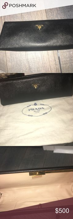Prada clutch Authentic Prada clutch in black saffiano lux leather Perfect evening bag very sturdy Not many signs of wear  Gold hardware  Opens by button on side  Very clean inside  Comes with dustbag  Purchased at www.prada.com Prada Bags Clutches & Wristlets