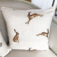 """Beautiful Handmade Peony and Sage Linen Cushions in four different designs. Choose from """"Plain hares"""" """"Hares with spots"""" """"Plain feathers""""..."""