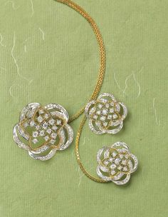 Tanishq Zyra collection white and yellow gold hydrangea earrings and necklace with white diamonds.