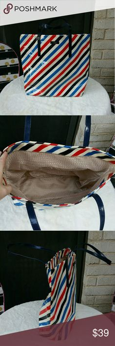 """Kate Spade Large Red White Blue Stripe Tote Bag Kate Spade Large and in charge tote in bold red white and blue stripes. Great condition with some marks on bottom as shown in photo. Perfect addition to your summer wardrobe! Measurements: 131""""Height Not including handles  Handle drop is 9"""" 13""""across front 5"""" depth  #ravenkittystyle #katespade #stripes #tote #purse #Large #redwhiteblue #holiday #vacation #staycation #summer #katespadeofnewyork #designer #style #classic #nevergoesoutofstyle kate…"""