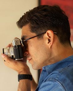 Narrative is the thread that ties a story together. And director Phillip Van has a story to tell. We visit the filmmaker at his home on our blog.  //  Phillip is shooting with a vintage  Yashica 35mm Rangefinder, circa 1973  //  Frame style featured here, our Richmond glasses in Red Havana  //    #DK_Richmond #photography #camera #eyewear #style #look #fashion #sunday #blog #davidkind