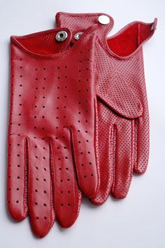 Red Leather Gloves.  If you have a sleek car, please also own these. Also great for leather jacket and motorcycles. I would love to own these red gloves. This really compliments suits aswell.