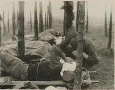 Medical attendant giving water to gassed patients of the 82nd and 89th  Divisions. Royaumeix, France. World War 1
