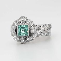 Beautiful 1.25ct t.w. Retro Emerald & Old Cut Diamond Ring 14k/Palladium/SS   Antique & Estate Jewelry   Jewelry Finds Price: $1850.00  A beautiful bright, seafoam green, natural emerald, sparkling antique cut accent diamonds, and a funky elegant 1940's era appropriate style makes this ring hard to pass up! This ring has one central baguette cut natural green emerald set in a clean bezel