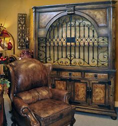 Consider Tuscan furniture that features rustic, distressed woods, hand painted designs, custom hand-applied finishes, arch details, hand-carved corbels, copper inlay on door fronts and scrolled wrought iron doors when creating Tuscan style interiors.