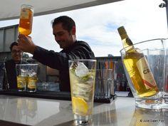Cocktail waiter prepares a port cocktail like the one already on the bar