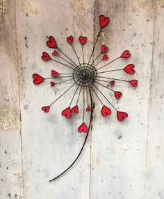 Pink dandelion flower in a tempered iron wire, in a wall decoration, in . - Pink dandelion flower in a tempered iron wire, in a wall decoration, in a metal … P - Wire Crafts, Diy And Crafts, Arts And Crafts, Wire Flowers, Fabric Flowers, Mural Floral, Fleurs Diy, Dandelion Flower, Deco Boheme