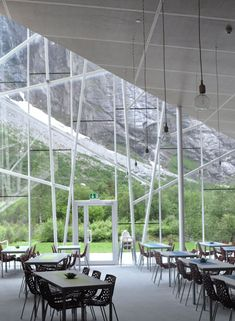 The jagged glass edges of this restaurant by Norwegian studio Reiulf Ramstad Architects point up towards a sheer cliff face. | Dezeen.com