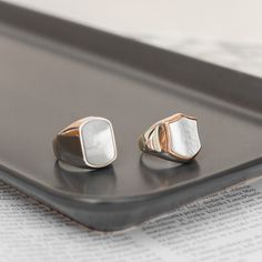 Mother of Pearl, also known as a protection stone, craved in these two beautiful rings with high polish as a final touch. Protection Stones, Pearl Ring, Beautiful Rings, Polish, Stud Earrings, Touch, Mens Fashion, Jewels, Ideas