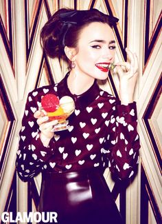 Lily Collins in Glamour, July 2013. Blouse, skirt, Burberry Prorsum; headband, Eugenia Kim; earrings, Pomellato. Photo: Ellen von Unwerth/Fashion editor: Anne Christensen