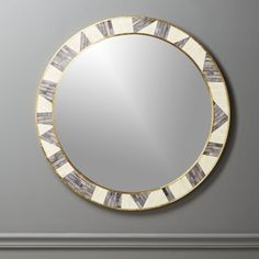 "Shop grace bone inlay mirror 32"".   Inspired by African murals, this graphic vision comes from the creative mind of Brett Beldock.  A mosaic of opalescent ivory and grey bone framed by two thin bands of brass.  Elegant and a little eclectic, our favorite."