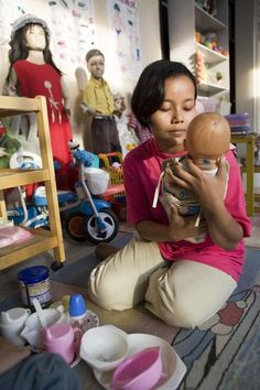 View image only  Susan Meiselas  View profile  INDONESIA. Jakarta. 2006. Women practice caring for babies in preparation to be domestic workers, Pt. Sumber Kencana Sejahtera Indonesia Training Center.