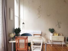 wallpaper by Elli Popp, mismatched chairs and door as table