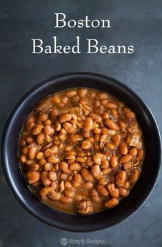 Slow cooked crockpot Boston Baked Beans! Loads of molasses flavor. Great with hot dogs or franks! On SimplyRecipes.com
