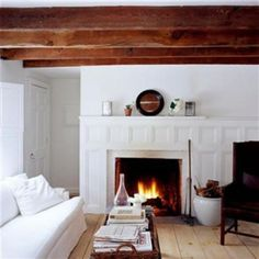 WHITE + GOLD: SNOW INSPIRED INTERIORS -- I kind of love the extended molding around the fireplace!