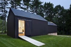 modern barn with black exterior and metal roof by Roger Ferris- #contemporary #barn  #architecture
