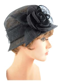 A hat to wear to complete your Downton Abbey or Gatsby inspired look. This black sinamay cloche is the classic topper for wearing with 1920s inspired dresses.