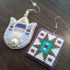 The earrings on the right are my #eotd and the ones on the left my version of the tulip (still available). The ones on the right are @c.holybear's.  I love the purples!