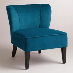 One of my favorite discoveries at WorldMarket.com: Peacock Quincy Chair | @Stephanie Elizabeth 2 of these accent chairs with this teal color pillows on a cream color couch!!!!!