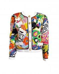 White cotton jacket from Escada featuring a jewel neck with a white trim, a front button closure, all over multicolored abstract print, textured gold-tone buttons, a check quilted design, long sleeves, buttoned cuffs with white trims and triple gold-tone button cuff. Item is in excellent vintage condition.