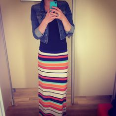 Bright striped maxi skirt layered with a short jean jacket and a simple T-shirt