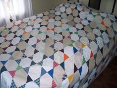 A quilt I had made for my son that includes clothing from 3 generations. Grandfather, father and son.