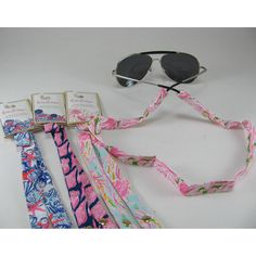 Lilly Pulitzer Sunglass Straps in Pink Colony, She She Shells, Cute As Shell and Jellies Be Jammin'. www.monogramsmarkingsandmore.com