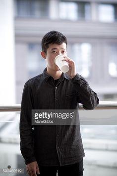 ストックフォト : Young man is drinking coffee