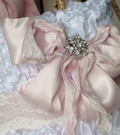 bow...pink satin bow with an antique brooch in the center....not exactly jewelry, but a great idea!