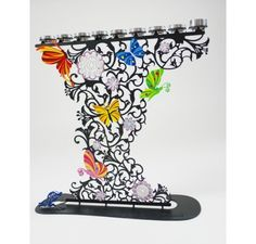 The Flowers and Butterflies Menorah by Israeli artist Alla Pikovski (Ra'anana, Israel) Laser cut metal  2 sides hand painted, each is a unique piece of art9 can