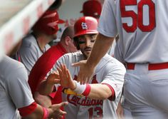 Matt Carpenter celebrates in the dugout after his home run against the Chicago Cubs... fifth inning. 7-25-14