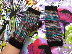 Fingerless mitts made with broken seed stitch.