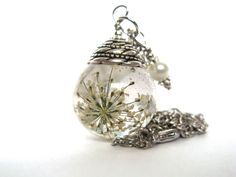 Beautiful Queen Annes Lace Resin Pendant Necklace Sphere  - Flowers encased in resin orb, Pressed Flower Jewelry. $15.00, via Etsy.