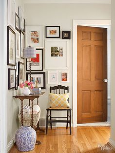 A gallery of family photos, prints, and artwork in a mix of black and white frames creates a happy vignette in the previously empty hallway. Hanging them en masse and nearly to the ceiling makes the space feel taller and puts precious pictures on view for guests and family alike.