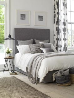 Grey upholstered bed by Button and Sprung