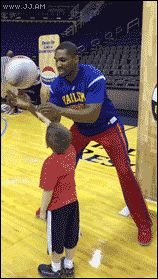 Harlem Globetrotter teaches a precious little kid how to spin a basketball on one finger and jump for joy