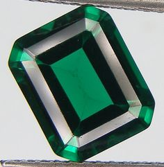 Product Name: Lab Created Emerald  Please note that stones color may look slightly different from the actual pieces!!  Gem Type: Lab-Created Item 1 Approx. Weight: 4.32 CT. Size : 11.1 x 9.1 x 5.7 mm.  Item 2 Approx. Weight: 4.36 CT. Size : 11.1 x 9.1 x 5.7 mm.  Shape: Octagon Or Emerald Cut  Specific Gravity: 2.90-3.10 Color:Green  Luster: Vitreous Hardness: 7 Refractive Index: 1.70  Treatment: Nanocrystal  Origin: Russia  Clarity: VS-SI  (Clarity Table Scale *IF No inclusions--Internally…