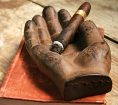 Cast Iron Hand    If you enjoy cigars or are just looking for a unique pocket change holder, check out this cool new Cast Iron Hand. This rustic appendage will last a lifetime holding whatever you want it to and makes a great gift.