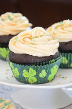 With a deep, dark chocolate flavor, these Chocolate Cupcakes with Bailey's Irish Cream Frosting are a great way to celebrate St. Patrick's Day!  The cupcakes are so easy to put together and the frosting is out of this world delicious! #StPatricksDay