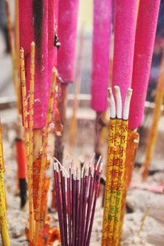 Burning incense also called joss sticks....many people go to the local temples to pray during the Chinese New Year.
