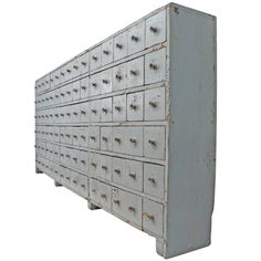 A monumental and graphically stunning 90 drawer apothecary cabinet with a beautifully distressed battleship grey painted surface. This wonderful piece came from the Stevens Linen Company in Massachusetts and dates back to 1842 when that company was formed. Exceptional scale, square-nail construction, original knobs and patina.