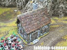 Beautiful tabletop building from tabletop-scenery.de I use it for my warhammer setting! :)