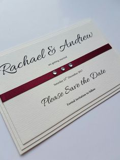 Classic wedding save the date idea with a burgundy satin ribbon detail and diamante