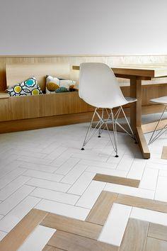 Esse chão.  Herringbone patterns feature inside angular house extension in Hackney, London