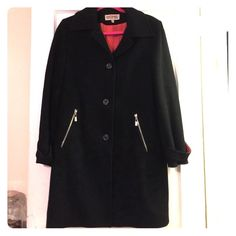 Michael Kors wool black button up coat. Size 6/8 Michael kors wool coat in black with button closures and silver hardware zip pockets. This is a size 6 but large (very roomy)I would say it's more of like an 8. Worn only a few times i can't just let this sit in the closet it's too pretty! In excellent condition no pulls, rips or stains! Retail and bought at Macy's for $289. Selling for a fraction! Accepting offers! MICHAEL Michael Kors Jackets & Coats Pea Coats
