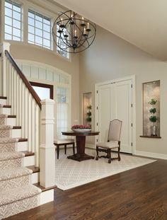 Gorgeous foyer with center table. Niches are lined with mother-of-pearl wallcovering. The 48 inch chandelier was custom made. Interior by Amy Weinstein --Stairs Up House, House Stairs, Carpet Stairs, Hallway Carpet, Design Studio, House Design, Franklin Homes, Foyer Staircase, Staircases